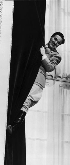"""At the time of The Great Dictator's first release (1940), the United States was still formally at peace with Nazi Germany. Chaplin's film advanced a stirring, controversial[4] condemnation of Adolf Hitler, Benito Mussolini's fascism, antisemitism, and the Nazis, whom he mocks in the film as """"machine men, with machine minds and machine hearts"""""""