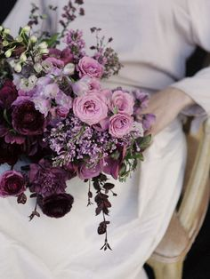 Purple toned bridal bouquet with ranunculus, lilacs, sweet peas and more. Lovely...