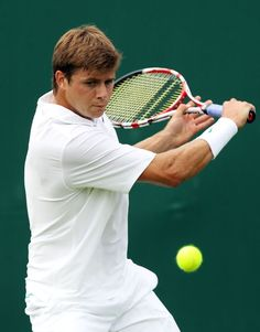 LONDON, ENGLAND - JUNE 25: Ryan Harrison of USA returns the ball during his mens singles first round match against on day one of the Wimbledon Lawn Tennis Championships at the All England Lawn Tennis and Croquet Club on June 25, 2012 in London, England. (Photo by Clive Rose/Getty Images)