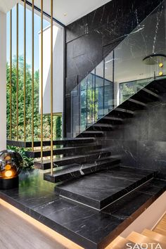 Ideas - This modern house has marble stairs with a glass handrail, that travel past a large floor-to-ceiling window.Stair Ideas - This modern house has marble stairs with a glass handrail, that travel past a large floor-to-ceiling window. Glass Handrail, Stair Handrail, Stair Risers, Houses Architecture, Staircase Architecture, Amazing Architecture, Home Architecture Design, Modern Residential Architecture, Innovative Architecture