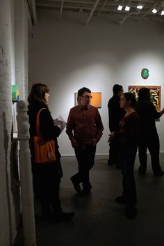 Visitors at the PAIR opening reception at PROTO Gallery