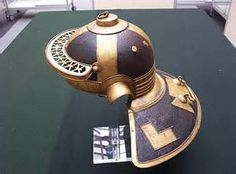 """The famous Niedermörmter Roman helmet of the late 2nd-early 3rd century AD. Side view. This style of helmet with hinged cheek pieces and a large neck protection was found in the river Rhine (now in the Mainz museum). It is a Weisenau type. Along with the elaborate applique and perforated brow, this helmet sports a unique design element on the crown: what are described as either """"Mice and cheese"""" or """"Mice and bread""""."""