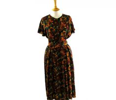 """90s Floral Dress Features a large floral print in mustard yellow, red ochre, blue and purple. #80sdress #vintagefashion #vintage #retro #vintageclothing #80s #1980s #vintagedress <link rel=""""canonical"""" href=""""http://www.blue17.co.uk/>"""