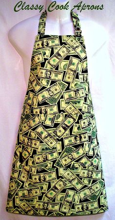 $35.50. Mans apron in designer screen print of US Currency in greys and greens on a black background. It's All About The Benjamins has every denomination from a single to a hundred dollar bill, and they look quite authentic! This fun apron has a fully functional double-sided front pocket, which makes it the perfect cooking accessory for the CEO of the BBQ.