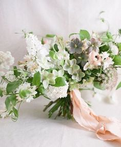 Beautiful Bridal Bouquet | Textured Bridal Bouquet with Blush, Grey, and White Florals | Muted Color Palette | Romantic Spring Wedding Details | Textured Ribbon Accent