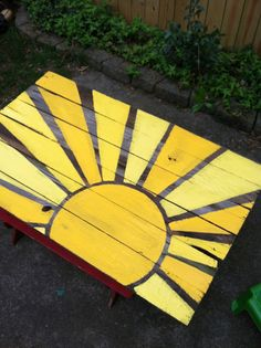 Love this painted wooden bench for the playground or backyard!