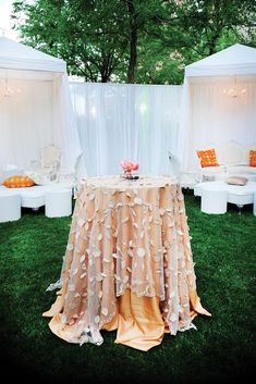 Decor Peach lounge seating cocktail table floral linen layered linens draping tenting private seating VIP chandelier