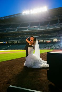 Fun baseball themed wedding at Minute Maid Park photographed by Carlino's Photography.