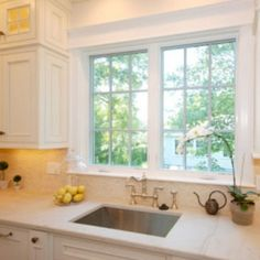 Use Nice Molding Around Window Over Sink Yellow Cabinets Corian Countertops