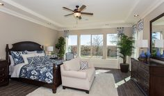 Traditional Master Bedroom with Ceiling fan, travertine tile floors, Trina Turk Indigo Ikat Comforter and Duvet Sets, Carpet