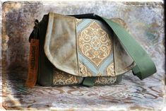 Blue Medallion and Leather DSLR Camera Bag by Porteen Gear.