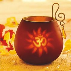 Decorative Om Tea-light in red color http://ashopi.com/Decorative-Om-Tea-light-in-red-color_4913.html