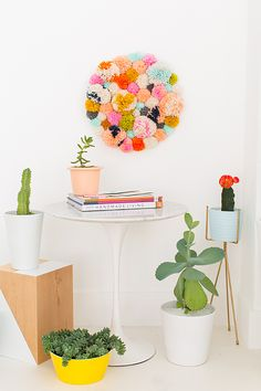 Obsessed with this DIY pom pom art.