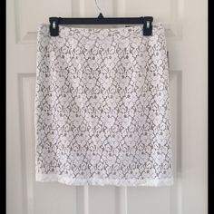 Lace Pencil Skirt Get ready for spring with this adorable lace pencil skirt. Beautiful white lace with a nude lining. New with tags, never been worn! Additional hook included with tag. Apt. 9 Skirts Pencil