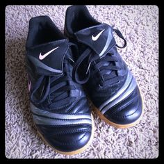 Soccer style sneakers Black, sliver and pink tennis shoes. They look like soccer cleats. The Nike swoosh is light pink. They are a re-posh because they were to small for me. I never wore them outside. Clean with not scratches or fading. Nike Shoes Athletic Shoes
