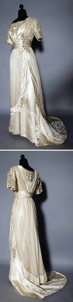 Evening gown ca. 1910. Cream silk charmeuse, embroidered appliqués, trained skirt. Augusta Auctions