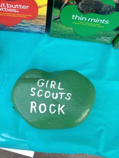 *Great 4 weighing down fable cloth corners-Girl Scout cookie booth Since we live in windy Lubbock Tx, found washed and painted rocks(acrylic and mod podge) for decoration but also to keep things from blowing away!