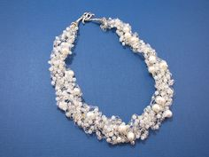I created this lovely 6-strand wire crochet necklace using fresh water pearls, Swarovski crystals and seed beads.  A wonderful combination indeed!