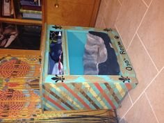 Old cabinet turned into my dogs room.  His shirts and sweaters along with other doggie needs store in the cubbie above his bed!