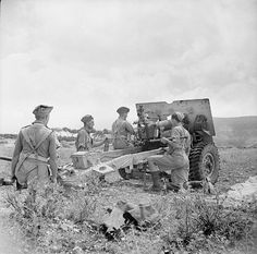 25-pounder field gun of 153rd Field Regiment (Leicestershire Yeomanry) during a practice shoot in the mountains near Tripoli in the Lebanon, 7 June 1943.