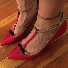 Zara red pumps Zara Woman t-strap red patent leather heels. These cuties feature a black bow and taupe accents. Only worn twice and like new. Retail at $89. They are size 8 (39). Zara Shoes Heels