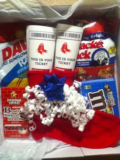 Great way to give tickets as a gift instead of just in a card! These are Boston Red Sox tickets presented inside red socks with cracker jacks, sun flower seeds, and other candy! Can add big league chew as well Red Sox Tickets, Baseball Tickets, Holiday Fun, Holiday Gifts, Homeade Gifts, Baseball Gifts, Baseball Party, Graduation Gifts For Him, 25 Days Of Christmas