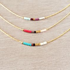 Minimalist Gold Delicate Short Necklace with Tiny Beads // Thin Layering Necklace // Colorful & Simple Boho Gift Necklace by Kurafuchi on Etsy https://www.etsy.com/listing/240230866/minimalist-gold-delicate-short-necklace