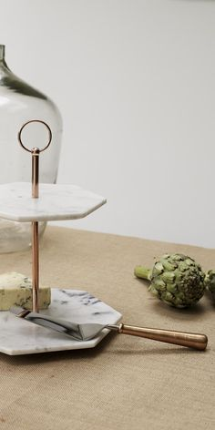 Our handcrafted Double Tiered Marble Cake Stand with its angular lines and unusual hexagonal shape makes a sophisticated Christmas gift for her. Home Interior Accessories, Kitchen Necessities, Oliver Bonas, Marble Cake, Apt Ideas, Christmas Gifts For Her, Furniture Collection, Place Card Holders, House Design