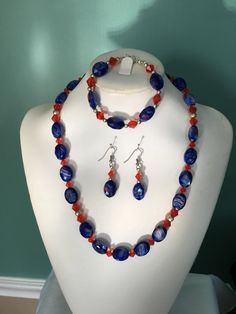 Necklace, earrings, and bracelet blue and orange crystal by CoolBeadsDesign on Etsy