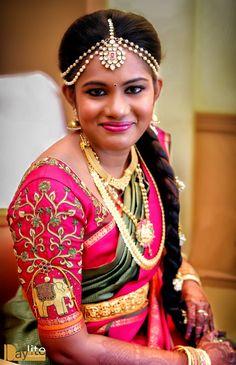 South Indian bride. Gold Indian bridal jewelry.Temple jewelry. Jhumkis.Pink and olive green silk kanchipuram sari.Braid with fresh jasmine flowers. Tamil bride. Telugu bride. Kannada bride. Hindu bride. Malayalee bride.Kerala bride.South Indian wedding.