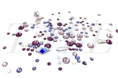 Mixed pack of Swarovski 155pcs  Inspired by February's birthstone Amethyst we have put together this collection for you.  Contains:  Amethyst  - SS7 30pcs  - SS20 10pcs  Light Amethyst  - SS12 20pcs  - SS20 10pcs  Tanzanite  - SS7 30pcs  - SS12 20pcs  White Opal  -SS7 30pcs  Shapes 1pcs each  - 2770 Clear  - 2716 Clear  - 2304 10 x 2.8mm Clear  - 22709 AB  -4428 5mm AB