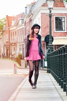 Black fishnet tights with short pink wool dress and jacket