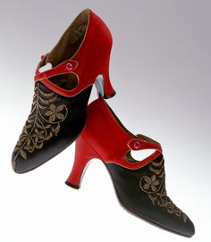 """Pumps, André Perugia: 1920's, embroidered silk satin, buttoned straps. """"...Skirt-length rose up to the knee and shoes played an important role in the fashion of the time. Because of this trend, shoe designers who functioned differently from conventional shoe craftsmen became active. André Perugia gained his fame making shoe designs for Paul Poiret, and he became known as one of the most talented shoe designers in the first half of the 20th century..."""""""