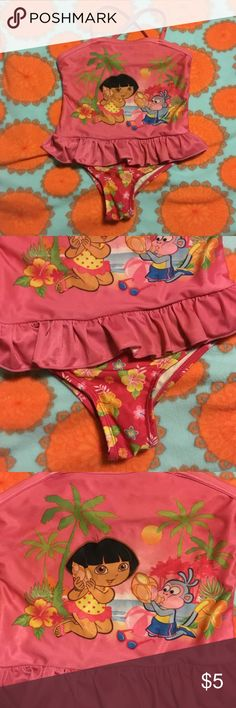Pink Dora Ruffle One-Piece Swimsuit - 4T Thank you for taking the time to browse my shop. Feel free to bundle & Negotiate.   Size: 4t  Brand: nickelodeon   Details: ruffle design. Cross back straps. One piece. Has spot on strep may or may not come out will fade with remover that's for sure. Dora and boots graphic on front   Color: pink graphic   Condition: good used   *Used items may contain piling &/or signs of wash and wear, they are sold AS Described.  Have a Wonderful Day. Thank you for…