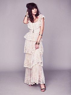 Great basic idea for a maxi dress from Free People, but needs adjustment to be flattering.  Eliminate ruffle that hangs over waist and creates sack of potatoes silhouette.