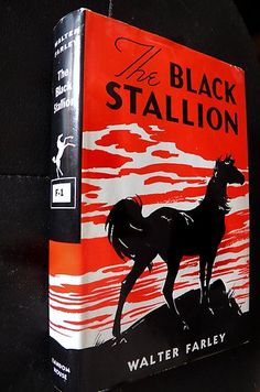 THE BLACK STALLION -  Walter Farley. I still have the whole book series. Read them so many times!