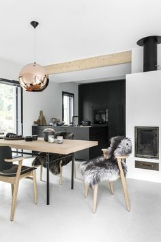 A beautiful all black kitchen and and dining room with lots of...