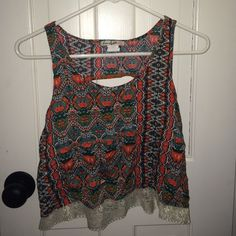Orange/green/cream crop top from Nordstrom rack 100% rayon. Not from free people, from Nordstrom rack! Offers welcomed!:) Free People Tops Crop Tops