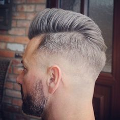 Medium faded #pompador style, slightly split and blown high and the front and lower at the crown!!
