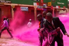 Police spray Ugandan opposition party leaders with colored water during demonstrations in the capital Kampala on May 10.