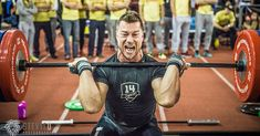 crossfit athlete squat clean barbell lift after injury