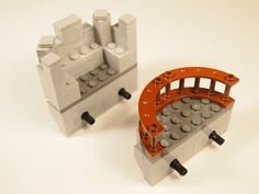 Lego Modular Castle. Here are two different versions of hybrid between a balcony module and a battement module. These clip directly into the pin holes rather than sitting on top of a balcony, room or bridge.