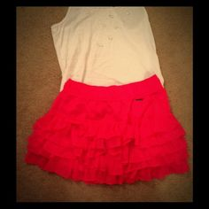 Abercrombie and Fitch size large ruffled skirt Great for summer! This never worn Abercrombie and Fitch skirt is hot pink and has super cute ruffles. It is a size large. Could be worn casually, dressed up, or to work. Amazing deal! Abercrombie & Fitch Skirts