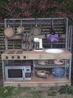 "broken recycled items for a kids ""mud"" kitchen. Outdoor Play Kitchen, Mud Kitchen For Kids, Mud Pie Kitchen, Kids Outdoor Play, Outdoor Play Spaces, Kitchen Stove, Outdoor Learning, Real Kitchen, Fibreglass Roof"