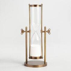 Imbue your home office with the handsome look of a vintage timepiece. Crafted of glass and metal with antiqued brass finish, this classic sand-filled hourglass is easily flipped to mark 60 minutes.