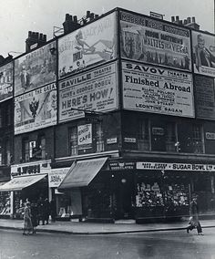 Confectionery Shop, corner of Greek St and Shaftesbury Ave, c. 1930 Look at all those damn ads!