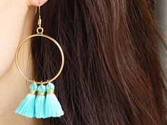 👑 Arctic Blue Tassle Earrings 👑  ▹ S i z e  - Length: 2.6 - Circle: 1.15 diameter   ▹ M a t e r i a l  - Gold plated brass (NO allergy)  ▹ P a c k a g i n g We pretty much understand that nice packaging can please every hearts so all items will be carefully and beautifully wrapped up with our own exclusive gift box.   If you have any requests or inquires, please feel free to contact us.   Love, Choker Saint   More beautiful designs? -> www.etsy.com/shop/chokersaint