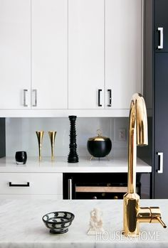 All white kitchen with sleek gold fixtures--repin via Mademoiselle Rose