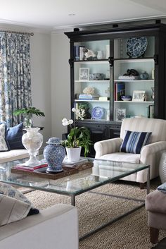 GEORGICA POND: Adding Black to your Room  I like the neutral tone on tone stripe fabric on the chair.