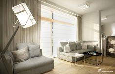 Aranżacja wnętrza z sofami Minotti, w oknach rolety rzymskie i zasłony. www.bartekwlodarczyk.com